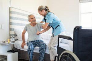 caregiver helping patient get up