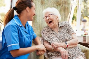 New Caregiver Having Good Time With Senior Patient